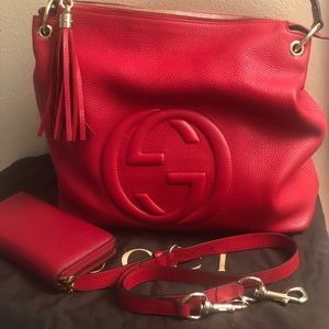 Red Gucci bag and wallet